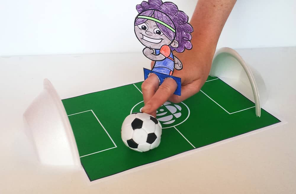 A child uses their fingers to