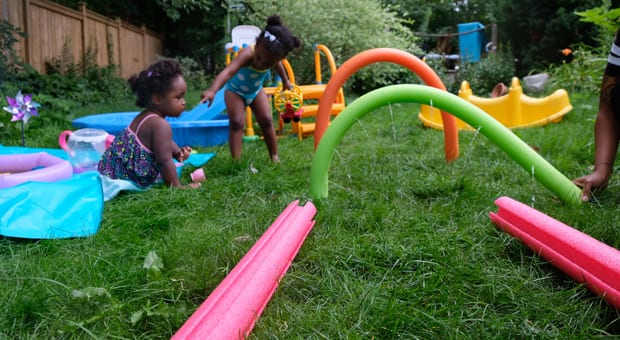 kids playing in a homemade splash pad