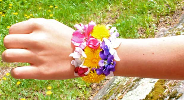 A bracelet made from brightly-coloured flowers.