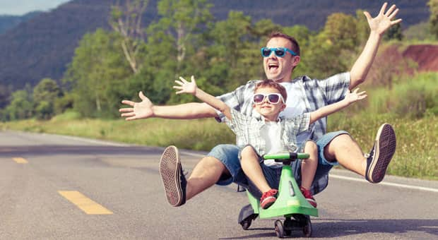 A father and child riding a bike.