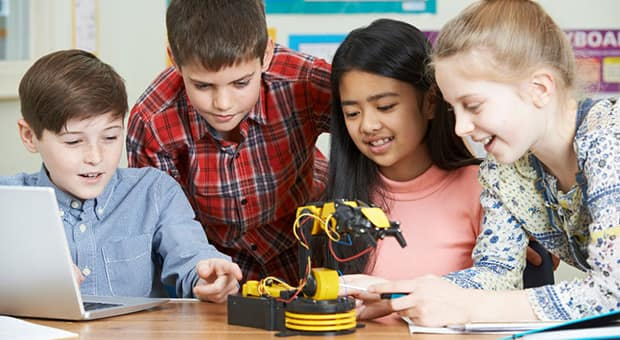 Kids working together to build a robot