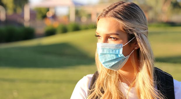 Young teen wearing a mask at school