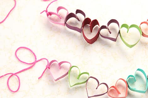 hearts glued together to form the garland with a string being tied to ends to hang it up