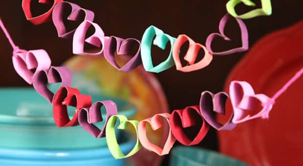 colourful garland of toilet paper roll hearts hanging up
