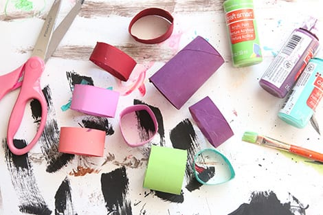 painting the toilet paper roll in bright colours and cutting it up into smaller loops