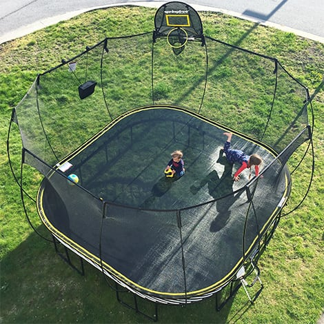 A birds-eye view of the kids playing on the trampoline.