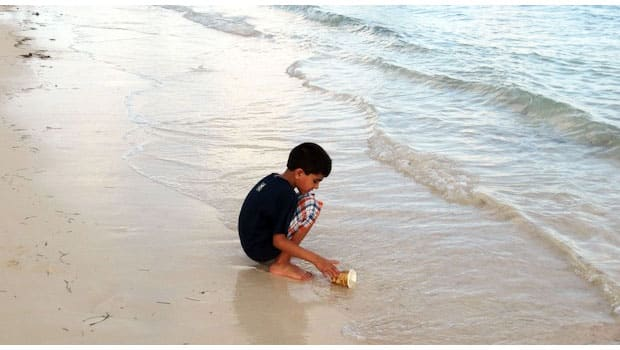 daughter plays in the sand at a resort