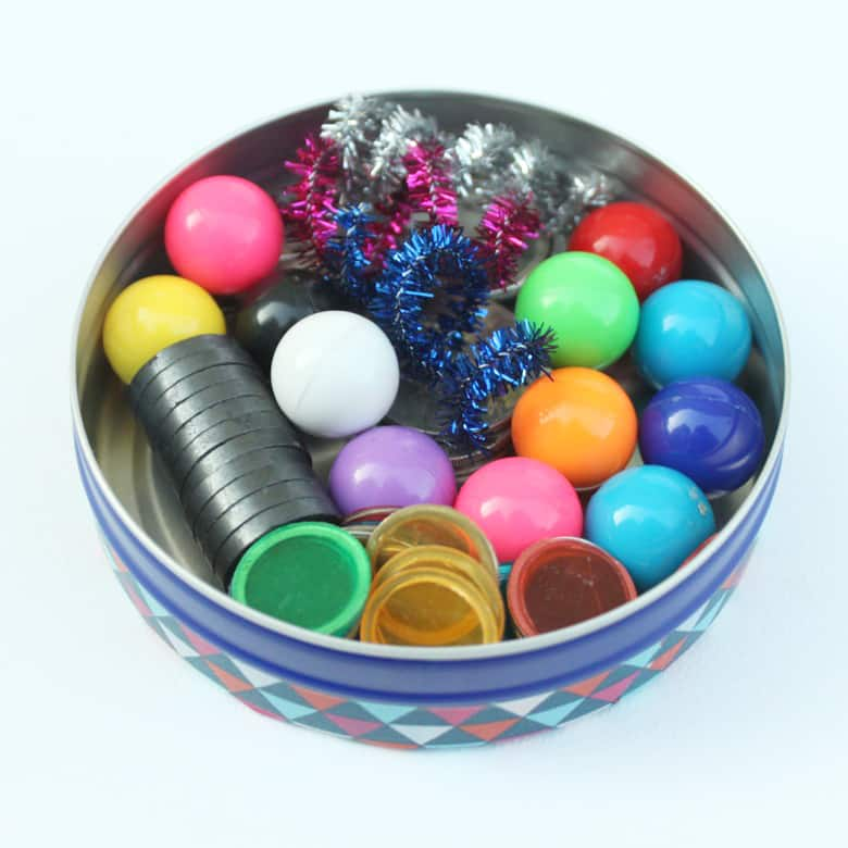 A tin filled with magnetic objects