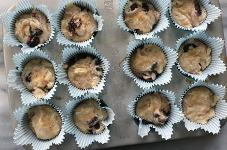Wet batter in muffin cups.