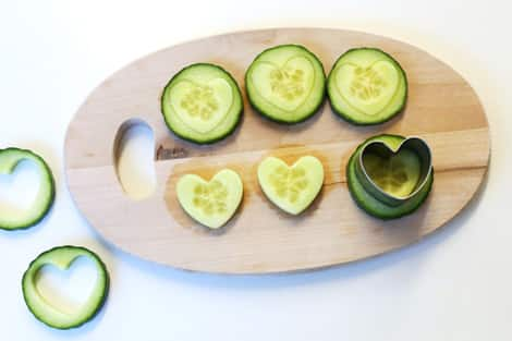 Cucumbers with hearts cut into the middle.