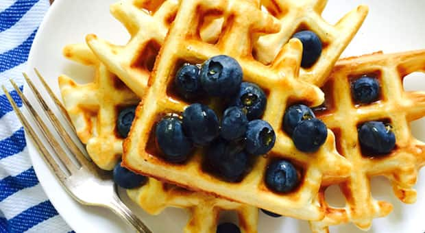 Multigrain Yogurt Waffles with syrup and blueberries