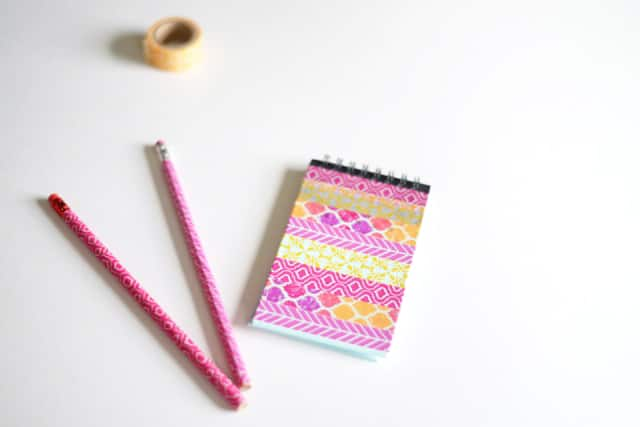 Pencils and notebooks covered with washi tape.