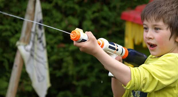 Child plays with a water gun