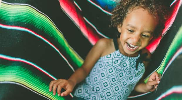 A young girl laughs