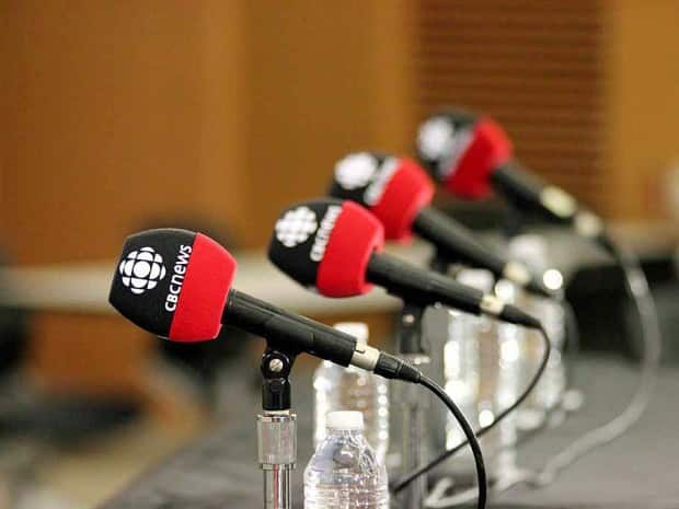 CBC microphones line the table