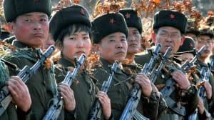 North Korean members of the Worker-Peasant Red Guards, stand guard.