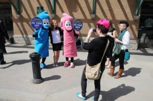 PETA protesters sport giant condoms