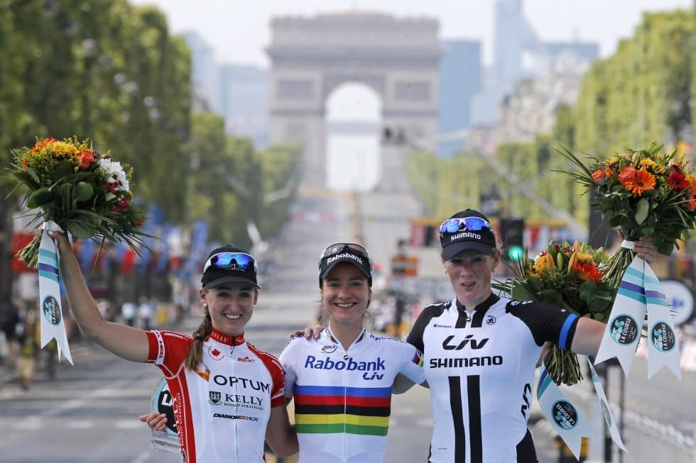 Leah Kirchmann far left celebrates on the podium of La Course female cycling race in Paris on July 27 2014 Laurent ReboursAssociated Press