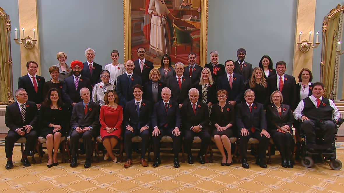 Prime Minister Justin Trudeau and his cabinet pose for a photo inside Rideau Hall in Ottawa, Wednesday, Nov. 4, 2015.