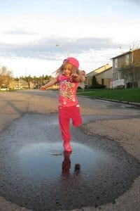 4-year-old Ella jumps in puddles in Chicoutimi. Photo submitted by Jules Penny.