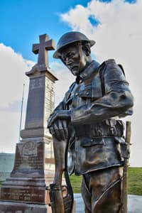 Thumbnail image for A statue of a First World War soldier, of the Royal Newfoundland Regiment, stands sentry at the Monument of Honour in Conception Bay South (Modelled after Chief Warrant Officer Terry Hurley).jpg