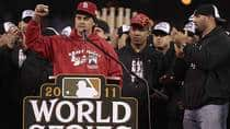 Manager Tony La Russa speaks to fans as Octavio Dotel and Albert Pujols of the St. Louis Cardinals look on during a ceremony celebrating the team's 11th World Series championship. (Whitney Curtis/Getty Images)