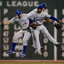 From left, Blue Jays' Travis Snider, Anthony Gose and Colby Rasmus celebrate Friday's 6-1 series-opening win at Boston. Toronto completed a three-game sweep Sunday with a 15-7 rout and scored a season-best 28 runs in the series to stay in the AL wild-card mix. (Winslow Townson/Associated Press)