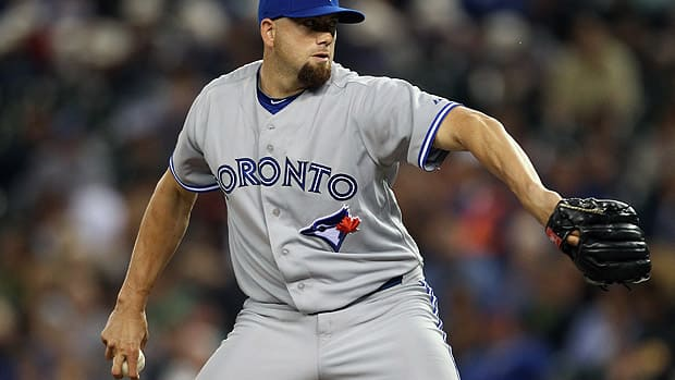 With Seattle this season, new Blue Jays relief pitcher Steve Delabar struck out 47 batters in 37 2/3 innings. More importantly, he's not eligible for arbitration until 2015 or for free agency until 2018. (Otto Greule Jr/Getty Images)