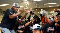 Detroit Tigers relief pitcher Jose Valverde, left, celebrates with teammates in the clubhouse after they clinched the AL Central with a win in Kansas City. (Orlin Wagner/Associated Press)