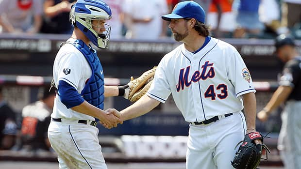 Knuckleballer R.A. Dickey, along with catcher Josh Thole, were traded to the Toronto Blue Jays on Monday. Dickey won the National League Cy Young award in 2012 after posting a 20-6 record with a 2.73 ERA for the New York Mets. (Jim McIsaac/Getty Images)