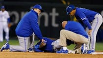 Blue Jays manager John Gibbons, left to right, trainer George Poulis and first base coach Dwayne Murphy tend to injured shortstop Jose Reyes at Kauffman Stadium in Kansas City, Mo., on April 12. (Orlin Wagner/Associated Press)