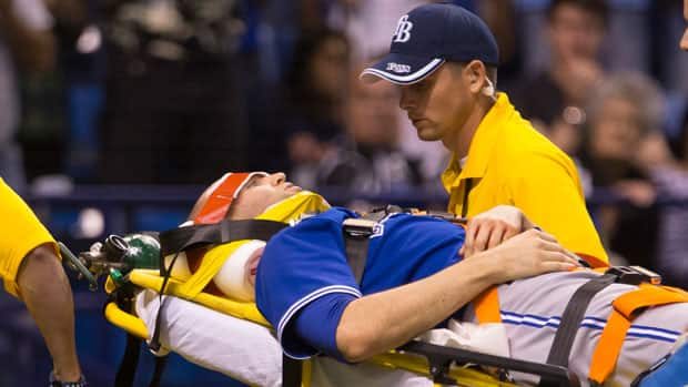 Toronto Blue Jays pitcher J.A. Happ is wheeled off the field on a stretcher after he was injured during the second inning against the Tampa Bay Rays in St. Petersburg, Fla. Tuesday. (Scott Audette/Reuters)