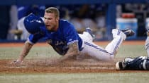 Brett Lawrie scores points for his hustle and intensity, but the Jays third baseman's high-strung playing style has also landed him in hot water. (Tom Szczerbowski/Getty Images)