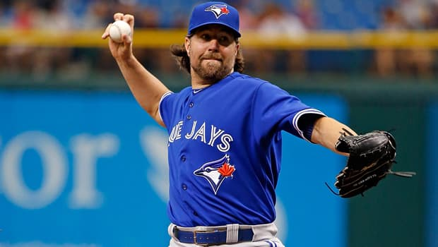 Blue Jays pitcher R.A. Dickey throws a knuckleball in a two-hit, complete-game 3-0 win over the Tampa Bay Rays on June 26. (J. Meric/Getty Images)