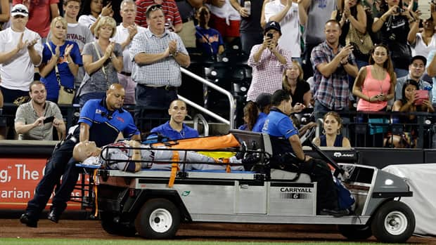 Atlanta Braves' Tim Hudson is carted off the field during the eighth inning of a baseball game against the New York Mets on Wednesday. (Frank Franklin II/Associated Press)