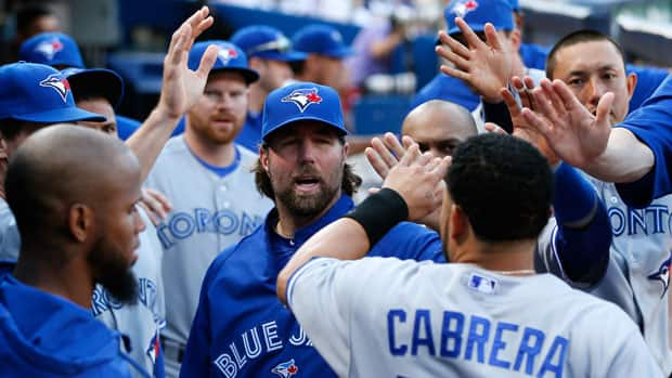 R.A. Dickey, centre, and the Blue Jays face a steep climb to reach contender status after the all-star break. (Kevin C. Cox/Getty Images)