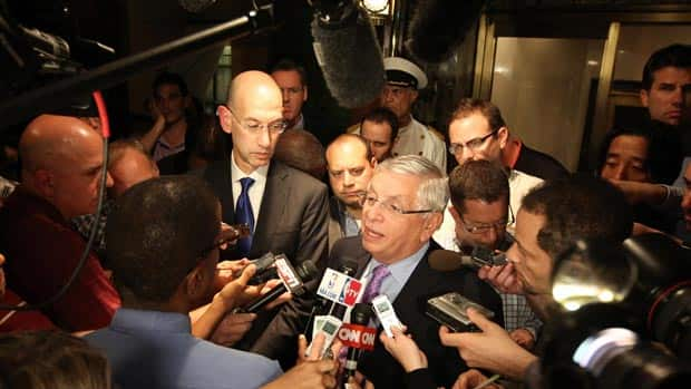 NBA Commissioner David Stern, centre, fell ill on Thursday amid ongoing labour talks between the league and the players' union. (Nathaniel S. Butler/NBAE via Getty Images)