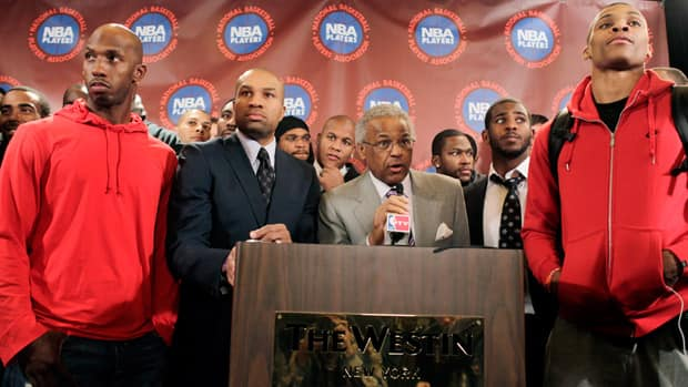 Many expected executive director Billy Hunter, centre, and the National Basketball Players Association would be the first to blink in the NBA labour dispute. (Seth Wenig/Associated Press)