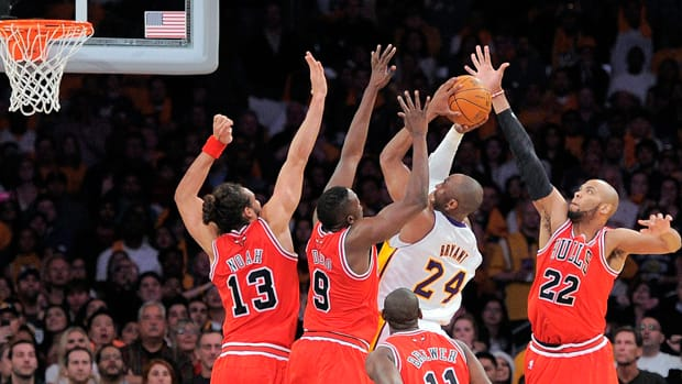 Los Angeles Lakers guard Kobe Bryant (24) puts up a shot against Chicago Bulls centre Joakim Noah (13), forward Luol Deng (9), guard Ronnie Brewer (11) and forward Taj Gibson as time expires in the second half on Sunday in Los Angeles. Bryant's shot was blocked and the Bulls won 88-87. (Mark J. Terrill/Associated Press)