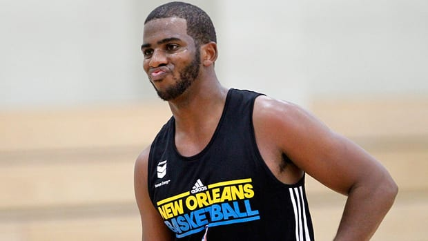 New Orleans Hornets guard Chris Paul participates in the first day of NBA basketball training camp in Westwego, La. last Friday. As of Tuesday, Paul was still a Hornet, but he is still actively trying to be traded to another, more competitive team. (Gerald Herbert/Associated Press)