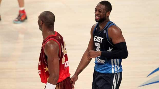 Miami Heat star Dwayne Wade, right, didn't apologize for breaking Kobe Bryant's nose during the NBA all-star game. (Bruce Yeung/Getty Images)