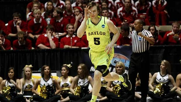 Brady Heslip of the Baylor Bears celebrates hitting a 3-point shot in the first half of the game against the Colorado Buffaloes during the third round of the 2012 NCAA Men's Basketball Tournament on Saturday. (Christian Petersen/Getty Images)