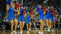 These Kansas Jayhawks cheerleaders will be cheering on their No. 2 seeded team against North Carolina State on Friday night.  (Eric Francis/Getty Images)