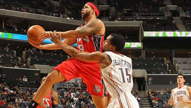 Gerald Henderson, right, of the Charlotte Bobcats attempts to block against Deron Williams, left, of the New Jersey Nets during Sunday's game in Charlotte. Williams had 57 points in the Nets' 104-101 victory. (Kent Smith/NBAE/Getty Images)