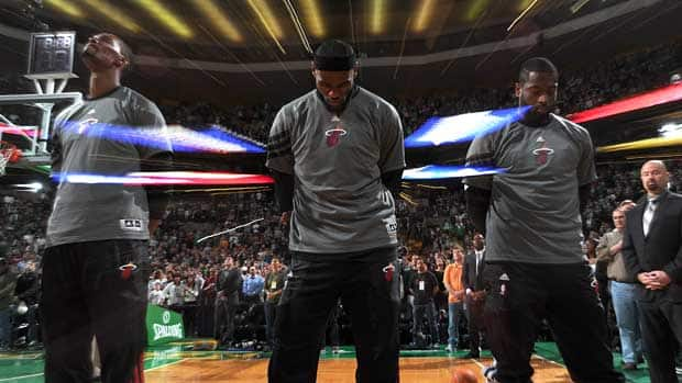 Chris Bosh, LeBron James and Dwayne Wade of the Miami Heat line up before a game against the Boston Celtics on Apr. 1. (Brian Babineau/NBAE via Getty Images)