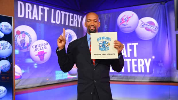 Head Coach Monty Williams of the New Orleans Hornets holds up the winning card during the 2012 NBA Draft Lottery on Wednesday. (Jesse D. Garrabrant/NBAE via Getty Images)