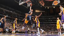 JaVale McGee (34) of the Nuggets dunks for two of his 21 points coming off the bench in Tuesday's 102-99 victory over the Lakers in Game 5 of the Western Conference quarter-final at Staples Center. (Andrew D. Bernstein/Getty Images)