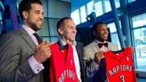 Toronto Raptors president and general manager Bryan Colangelo (centre) picked up new players Landry Fields (left), and Kyle Lowry, but questions remain about how they fit into the roster. (Ian Willms/Canadian Press)