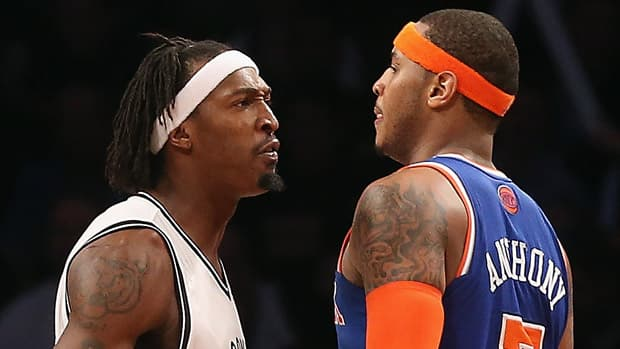 Gerald Wallace, left, of the Brooklyn Nets confronts Carmelo Anthony of the New York Knicks in the closing minutes of overtime at the Barclays Center on Monday night in the Brooklyn borough of New York City. (Bruce Bennett/Getty Images)