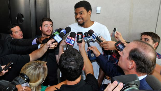 Andrew Bynum speaks to Philadelphia reporters upon being traded to the 76ers on Aug. 15. (David Dow/Getty Images)
